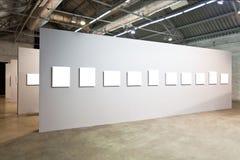 Grey walls with many frames Stock Photos