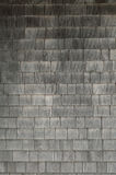 Grey weathered cedar shakes shingles background. Neat. tidy. newer grey cedar shakes shingles background Royalty Free Stock Image