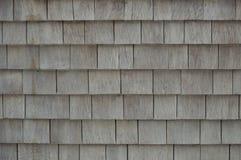 Grey weathered cedar shakes shingles background Stock Photos