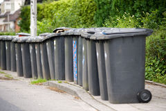 Grey wheelie bins Stock Photography