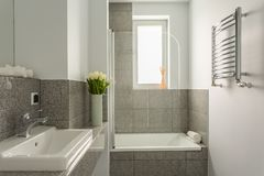 Grey and white bathroom Stock Photography