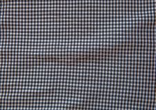 Grey and white checkered fabric texture background royalty free stock photography