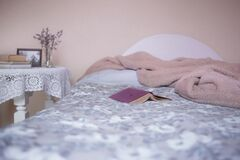 Grey and White Floral Bed Comforter Stock Photos