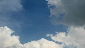 Grey and white fluffy clouds floating on the blue tropical rainy season sky of bangkok stock video