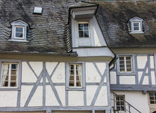 Grey and white half-timbered house Stock Photos
