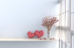 Grey-White living room decor with two hearts for valentine day. Grey-White living room decor with two hearts ,white wall, window, table, pink rose,vase, drape stock photography