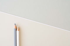 Grey and white pencils Stock Photos