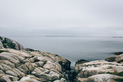 Grey and White Rocks Near Body of Water Photograph Royalty Free Stock Image