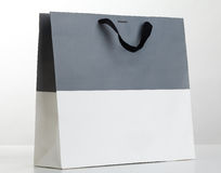 Grey and white shopping bag. Royalty Free Stock Photos