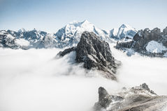 Grey and White Snow Covered Mountains and White Cloud Bank Royalty Free Stock Photos
