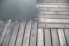 Grey wood pier by the lake Stock Photography