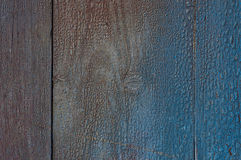 Grey wooden background with cracked blue paint on the surface. Gradient, paint colors royalty free stock image