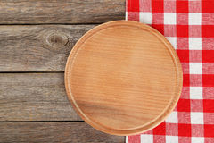 Grey wooden background with napkin with cutting board Royalty Free Stock Photo