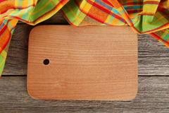 Grey wooden background with napkin and cutting board Royalty Free Stock Photos