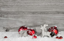 Grey wooden background with white and red classical christmas de Stock Photography