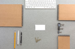 Grey Wooden Desk with Business Items in Calm Classic Colors Royalty Free Stock Images
