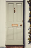Grey wooden English door on a bright sunny day closeup Royalty Free Stock Photography