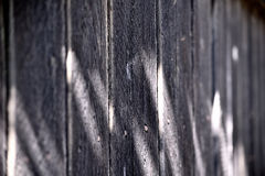 Grey Wooden Fence. At an oblique angle with shallow depth of field Stock Image