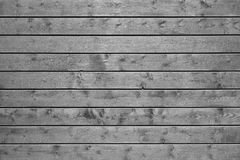 Grey wooden plank wall. Batten board background stock photography