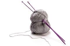 Grey wool and needles Royalty Free Stock Photos