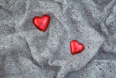 Grey wool, red hearts, Valentine stock photo