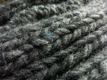 Grey wool scarf with one patch of blue. Close up of hand made Himalayan scarf from Nepal. One hundred percent wool. Gray with one speck of blue Royalty Free Stock Photos