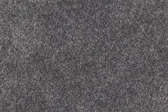 Grey woolen felt texture. Fabric stock photo