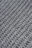 Grey woolen knitted scarf. Closeup view texture with bokeh. Vertical image stock photography