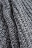 Grey woolen knitted scarf. Closeup view texture. Vertical image royalty free stock photos