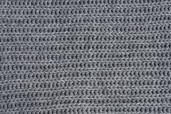 Grey woolen knitted scarf. Closeup view texture. Horizontal background stock photo