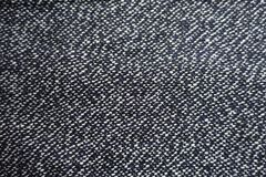 Grey tweed fabric surface from above Stock Photography