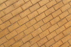 Grey yellow cobble stone pavement background Stock Images
