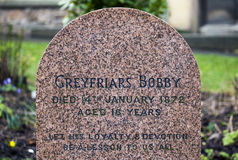 Greyfriars Bobby Grave in Edinburgh. EDINBURGH, SCOTLAND - MARCH 9TH 2016: A close-up of the grave of Greyfriars Bobby in Greyfriars Cemetery in Edinburgh, on Royalty Free Stock Photos