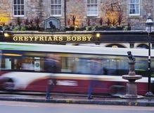 Greyfriars Bobby`s Bar in Edinburgh. UK, Scotland, Lothian, Edinburgh, Twilight view of the Greyfriars Bobby`s Bar and the sculpture of Bobby Royalty Free Stock Photography