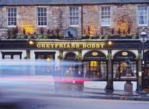 Greyfriars Bobby`s Bar in Edinburgh. UK, Scotland, Lothian, Edinburgh, Twilight view of the Greyfriars Bobby`s Bar and the sculpture of Bobby Royalty Free Stock Photo