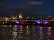 Greyfriars Bridge London. Londons Greyfriar Bridge lit up with different coloured lights at dusk with the London Skyline Stock Image