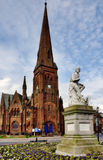 Greyfriars Church and Robbie Burns statue. View of Greyfriars Church, a Gothic structure built in 1868, and the statue of Robbie Burns, on a winters day in the Royalty Free Stock Photography