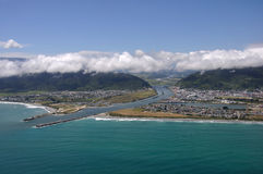 Greymouth. Aerial of Greymouth's suburb of Cobden and the mouth of the Grey River, West Coast, South Island, New Zealand Royalty Free Stock Photo