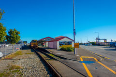 GREYMOUTH, NEW ZEALAND- MAY 24, 2017: Traffic waits for oncoming vehicles to cross a single lane road-rail bridge over Royalty Free Stock Photo