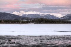 Greys and Torrey. The sun sets over mountains Greys and Torrey in Colorado, the frozen lake Dillon is in the foreground Royalty Free Stock Images
