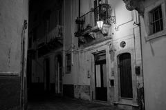 Greyscale Horizontal View of a Street Illuminated By Artificial. Light at Night. Martina Franca, South of Italy Royalty Free Stock Photography