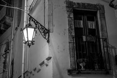 Greyscale Horizontal View of a Wall with a Closed Window  Illumi. Nated By the Artificial Light of a Street Lamp. Martina Franca, South of Italy Stock Photography
