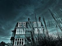 Greyscale House Photo Under Clouds Royalty Free Stock Image