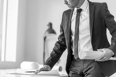Greyscale image of a businessman or expert writing observations Stock Photography