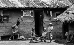 Greyscale Photo of Children in Front of a House at Daytime Royalty Free Stock Photo