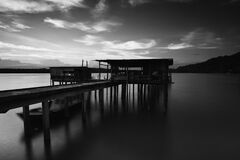 Greyscale Photo of Dock Near Mountains Stock Images
