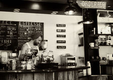 Greyscale Photo of Man Standing Beside Bar Counter Table Stock Image