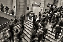 Greyscale Photo of People Going Up and Down the Stairs Stock Photos