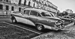 Greyscale Photo of Vintage Car Parked Beside Building Royalty Free Stock Photos