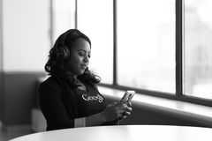 Greyscale Photo of Woman Holding a Smartphone royalty free stock image